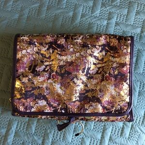 Purple and gold cosmetic travel bag